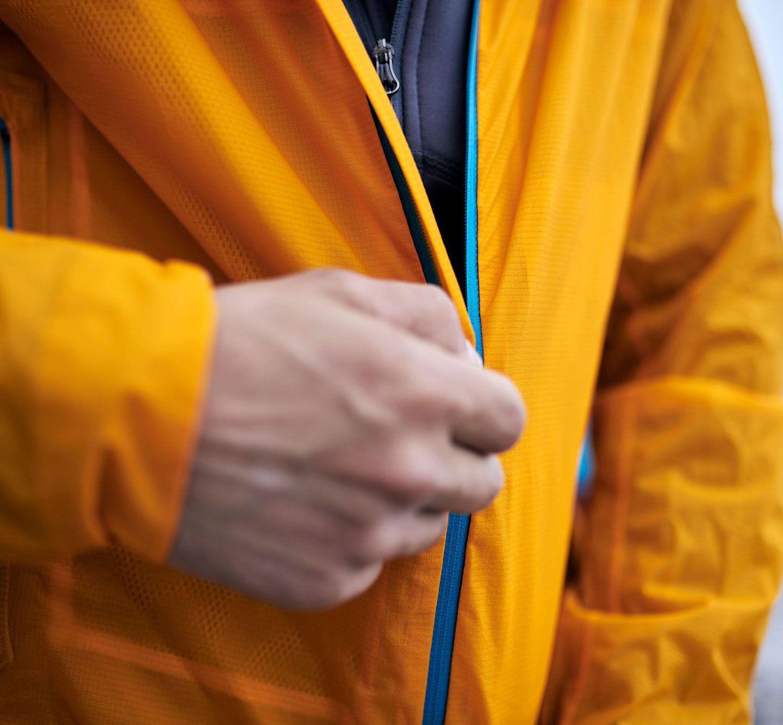 man zipping jacket